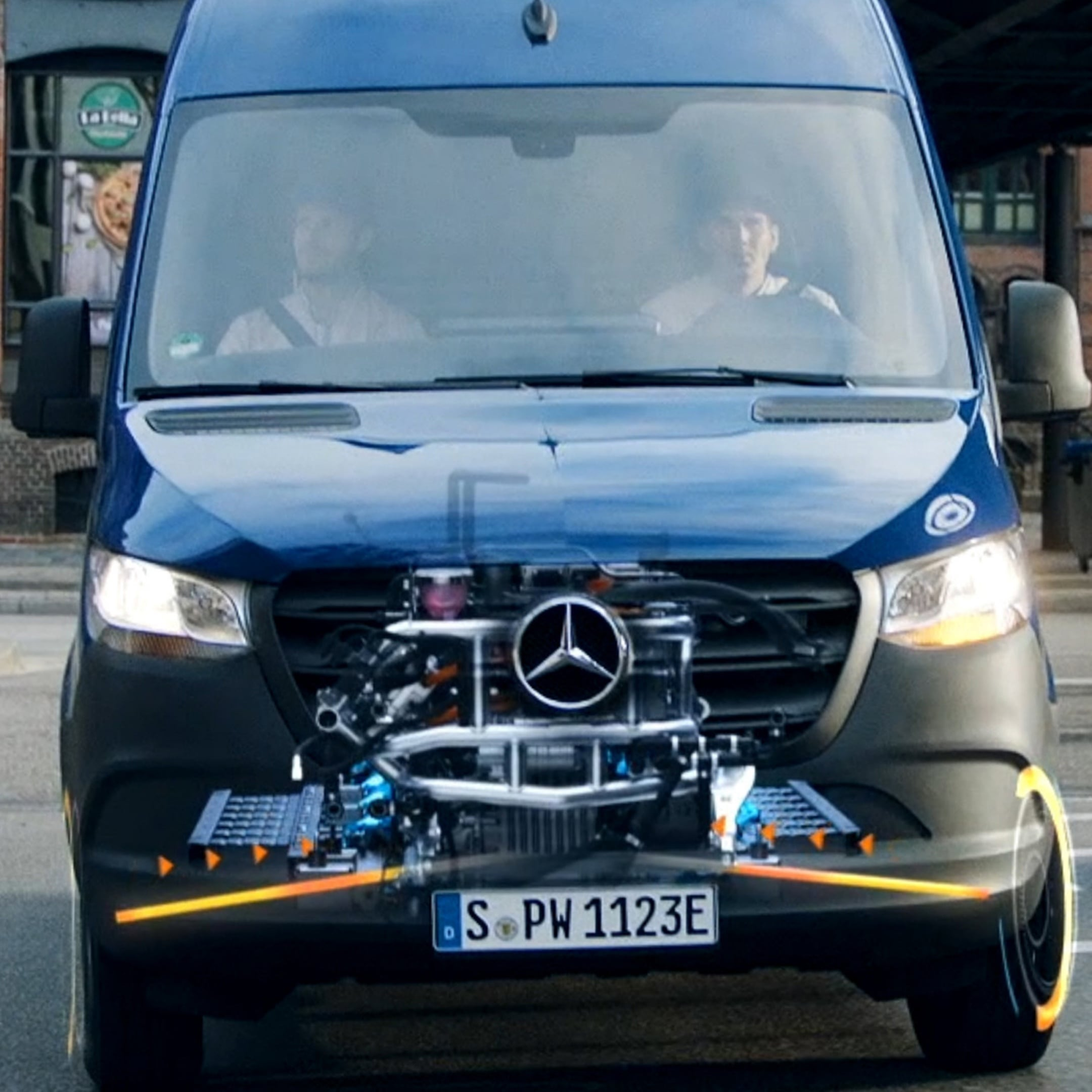 A Mercedes-Benz Sprinter driving along a road, with animated display of the e-drive
