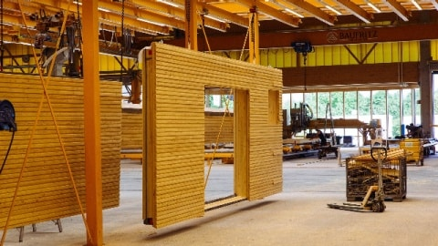 Inside view of a production facility with large-dimensioned wooden building elements