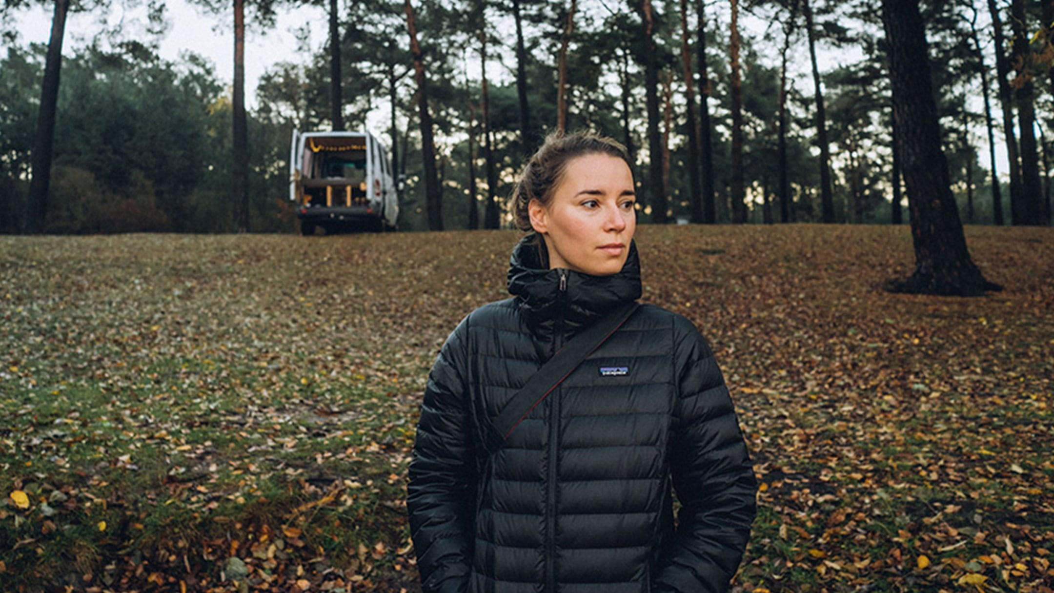Julia Nimke is driving in the forest with her Mercedes-Benz Sprinter