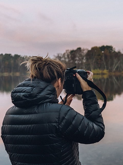 Julia Nimke taking photos on a lake at sunrise