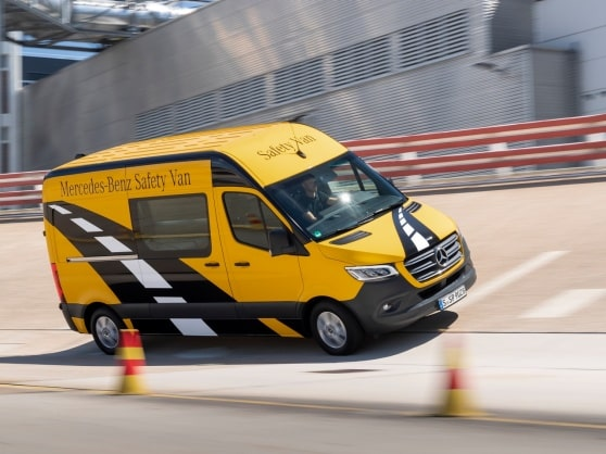 A Mercedes-Benz Sprinter is driving on a test track