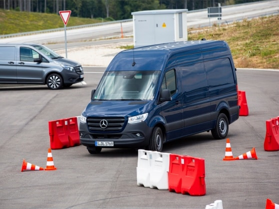 A Mercedes-Benz Sprinter driving along a narrow test track