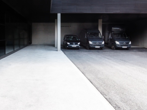 Three Mercedes-Benz vehicles park in front of Bernd Gruber's company HQ in Stuhlfelden