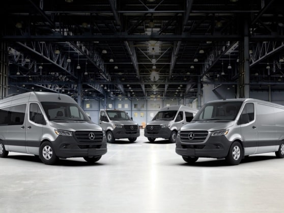 Different Mercedes-Benz Sprinter models in a hall.