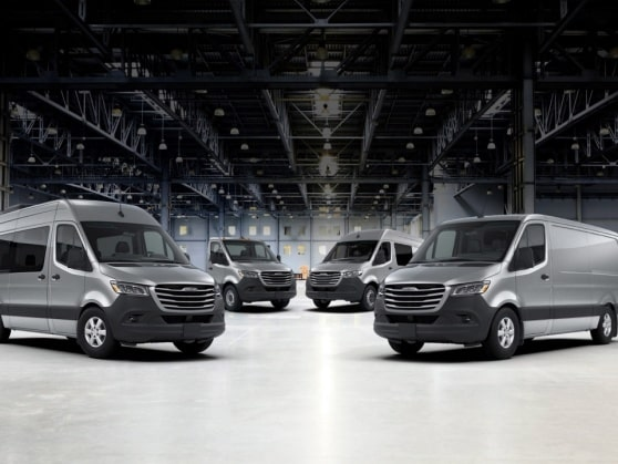 Different Freightliner Sprinter models in a hall.