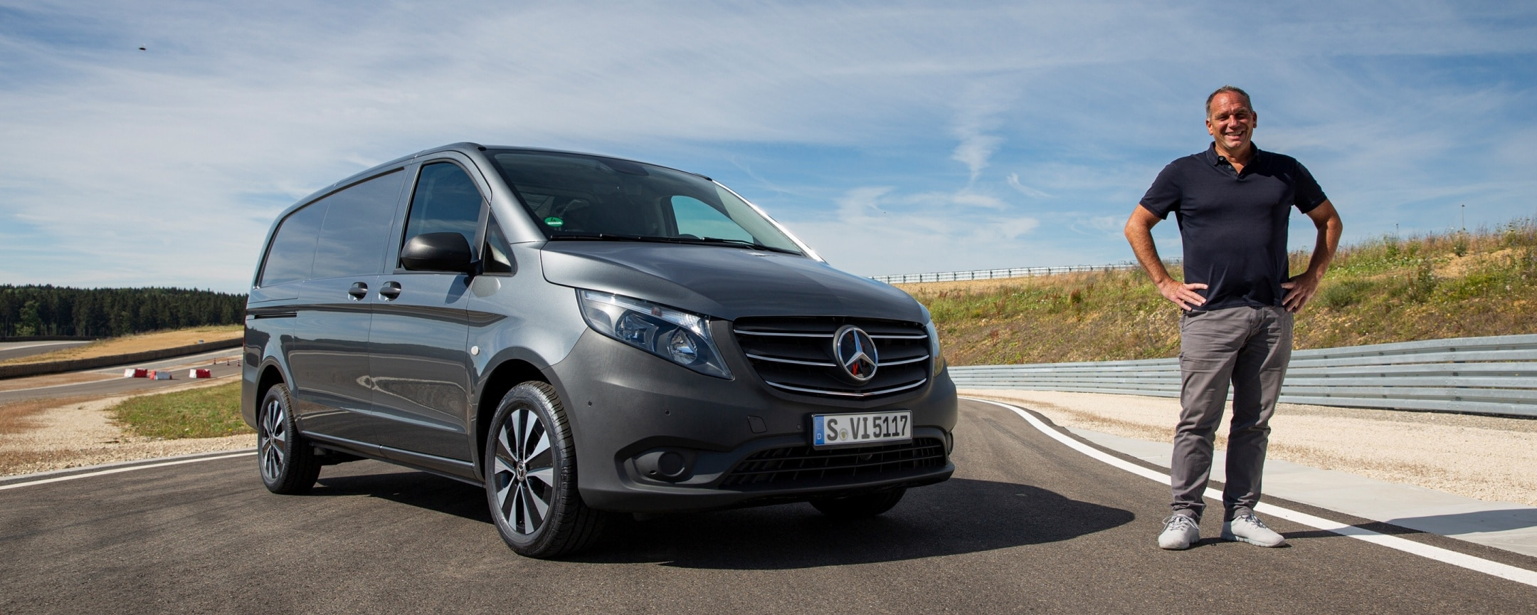 A man is standing next to the new Mercedes-Benz Vito.