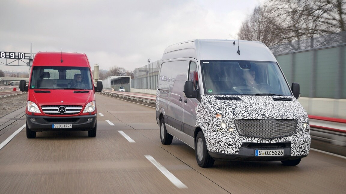Two Mercedes-Benz Sprinter vehicles are driving on the road