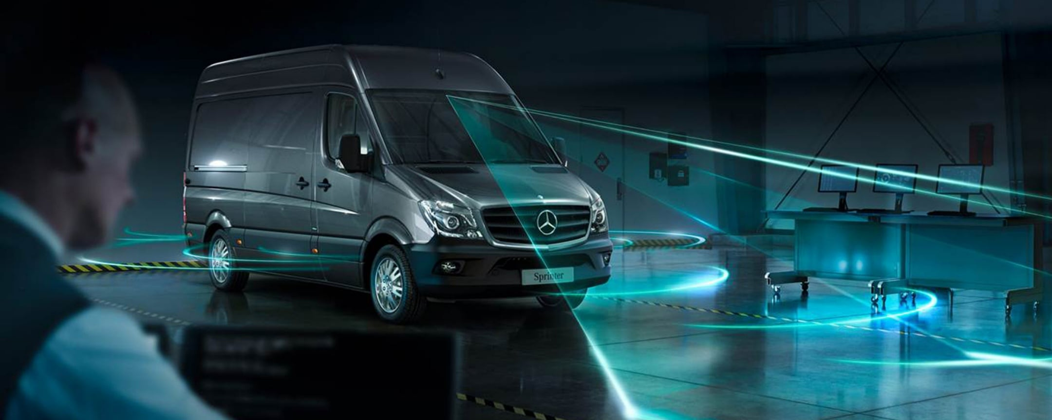 A Mercedes-Benz Sprinter in a darkened test room with visualised sensor rays