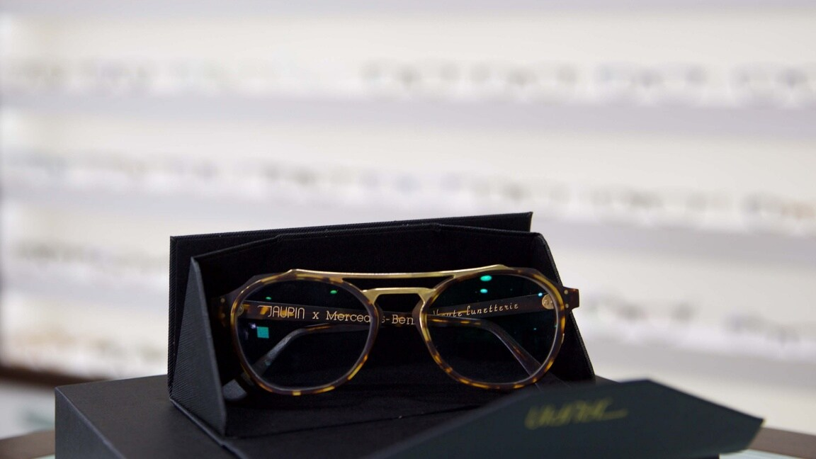 A pair of glasses in a box at the optician's