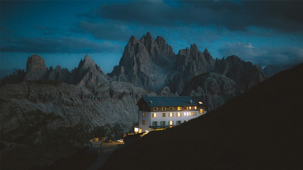 A night-time shot of a hotel in the Dolomites