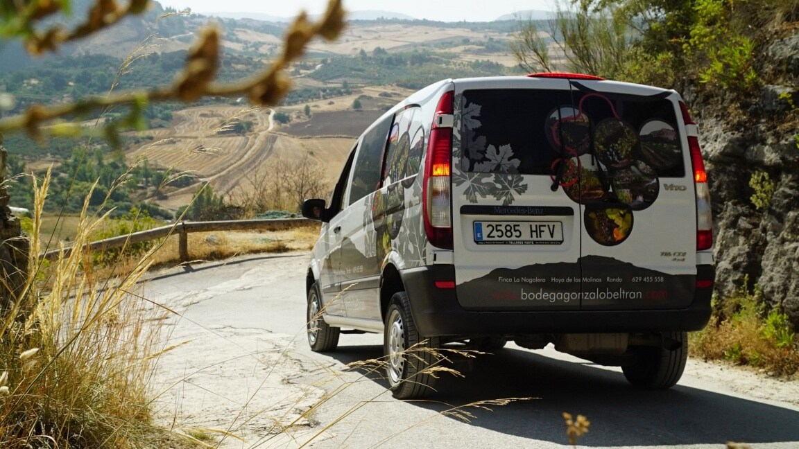 White Mercedes-Benz Vito driving in the mountains
