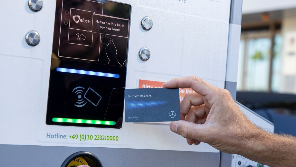 A chip card is held in front of a charging station