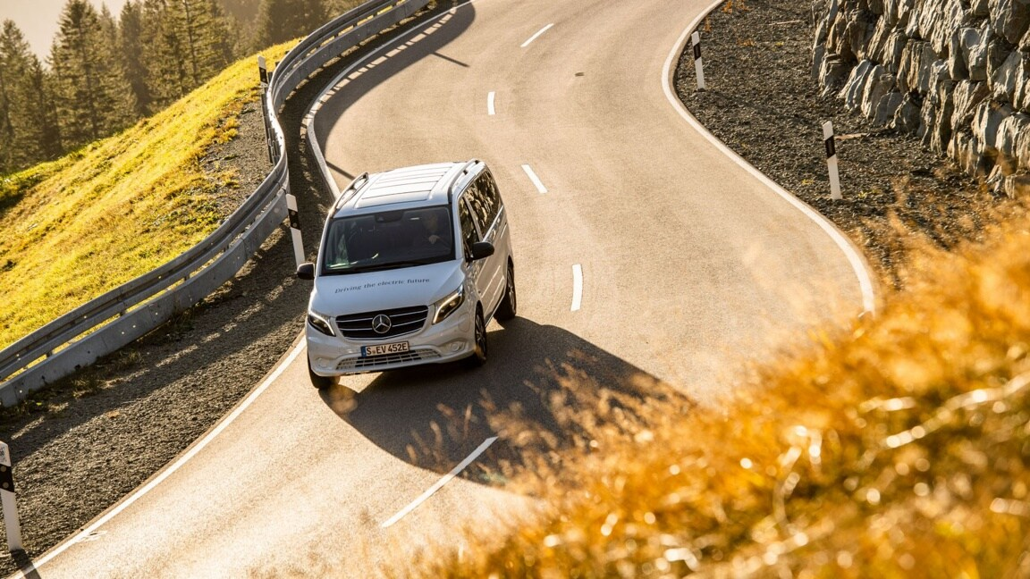 The Mercedes-Benz eVito Tourer drives down a mountain road
